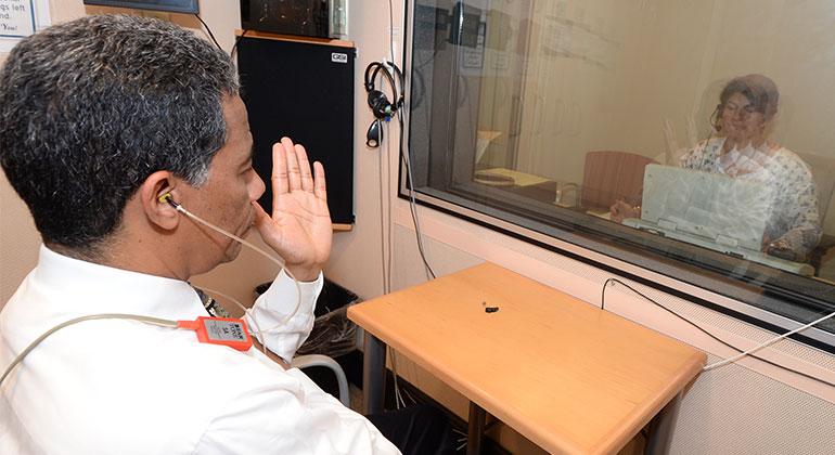 Image of doctor performing hearing test on patient