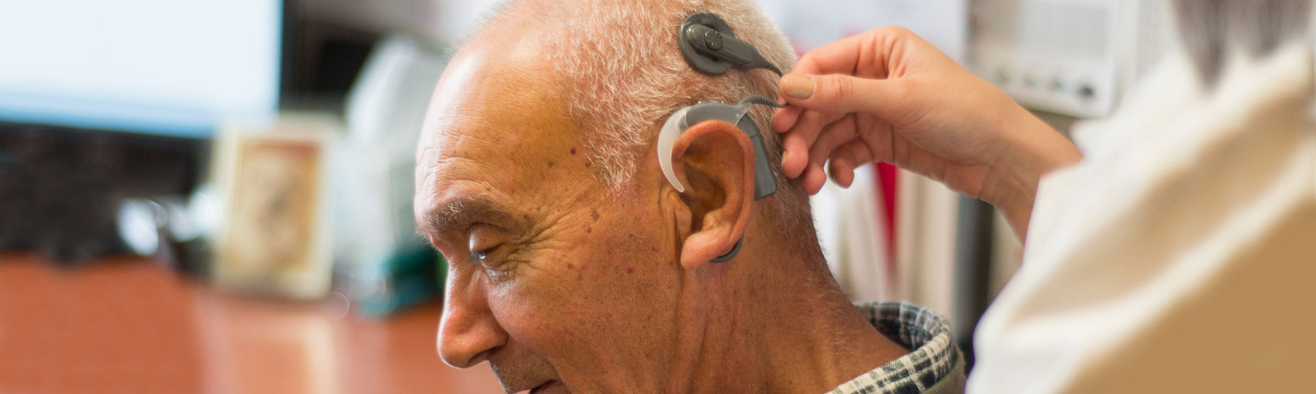 Image of male with Hearing aid device