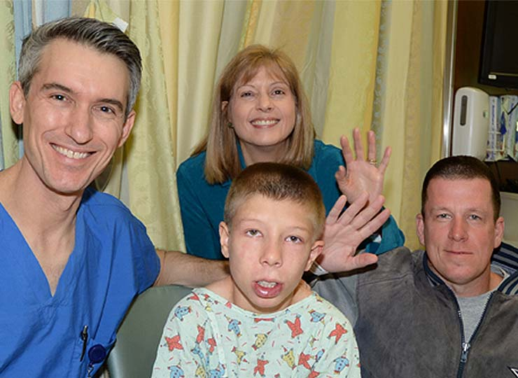Photo of Image of doctor Levitin with boy and and his family