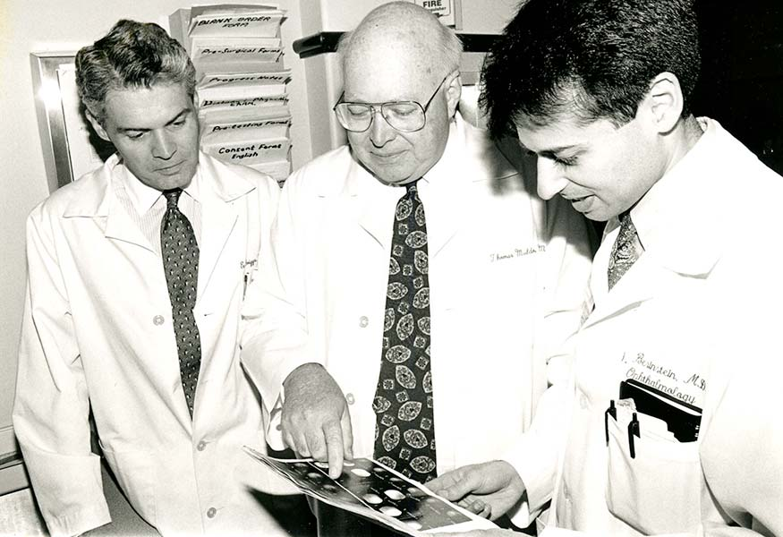 Dr. Thomas O. Muldoon and 2 other doctors consult