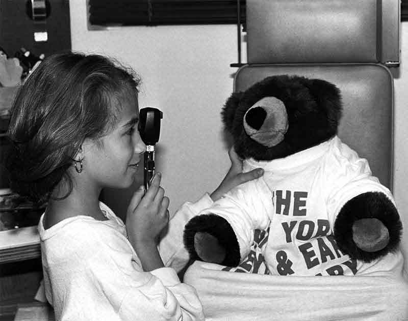 Girl and teddy bear in exam room